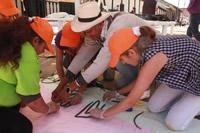 Este año los tapetes de flores en Madrid  integran trabajo de silletero paisa