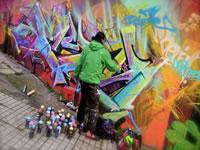 Indignación por borrado de grafitis en la calle 26