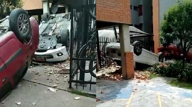 [VIDEO] Dos vehículos caen de un parqueadero y ocasionan fuerte accidente en Bogotá